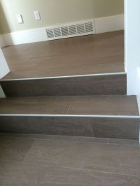 Wood floor tile on stairs with metal end cap | Painted ...