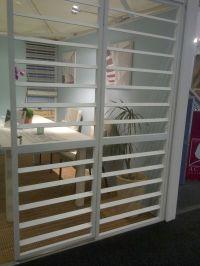 Burglar bars designed to look like shutters! So clever ...