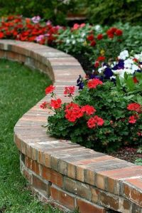 Flower beds, Raised flower beds and Diy retaining wall on ...
