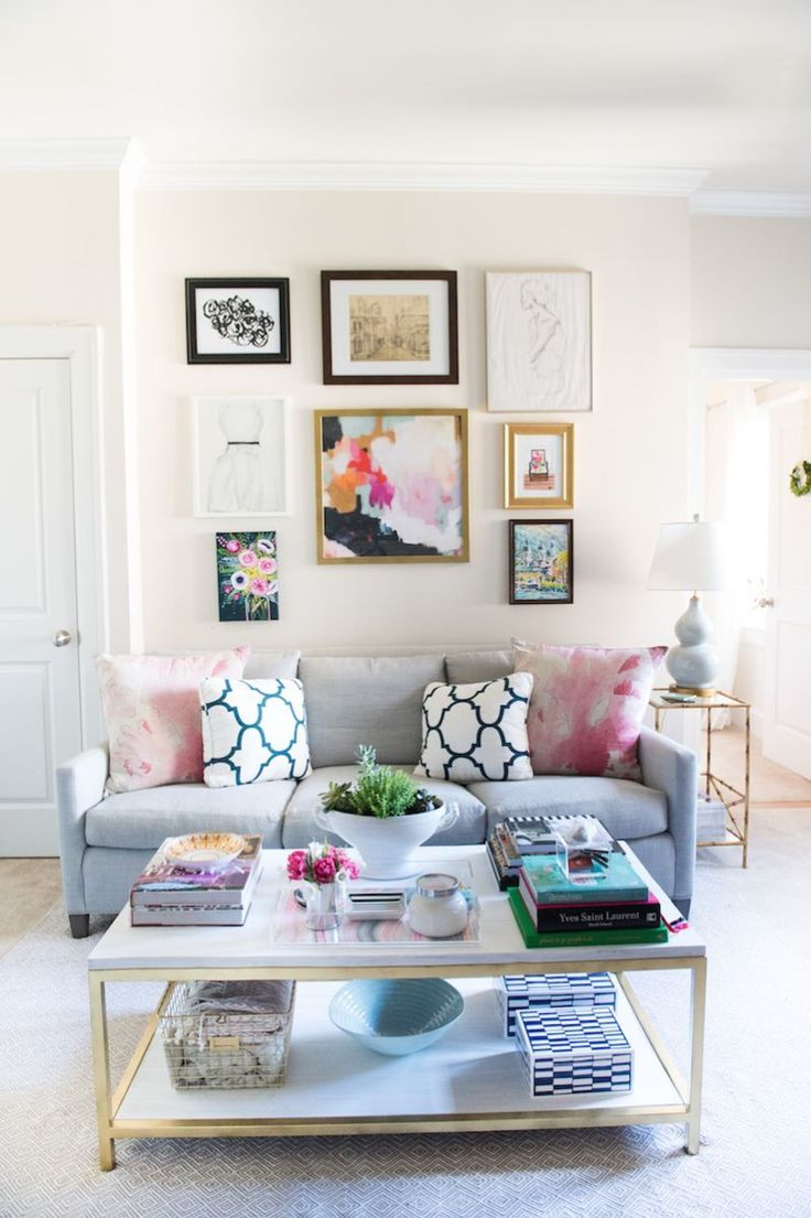 Like the small gold accents in this layout just a bit in the coffee table and the picture frame and side tables it s a bit on the girly side but i