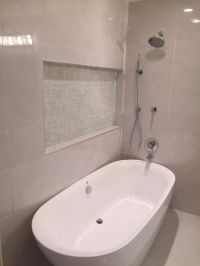White Porcelain Tile. Freestanding tub with shower combo ...