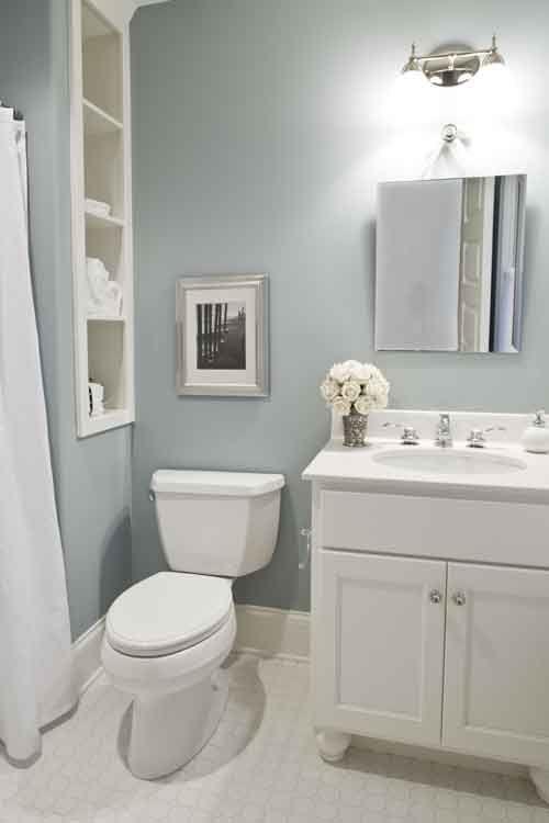 Duck egg blue bathroom with linen shelves bathroom