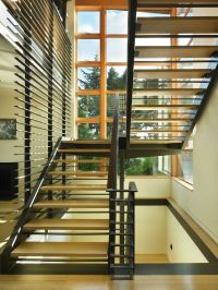 The open steel stair w/ bamboo treads 'floats' in the ...