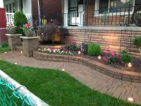 Raised flower bed with decorative stone and a Japanese ...