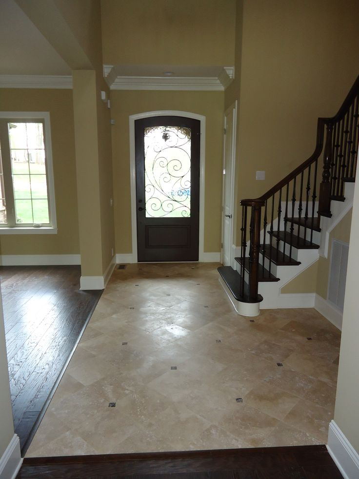 Change Color Of Kitchen Floor Tile The Saddlebrook Foyer With Travertine Flooring And Wrought