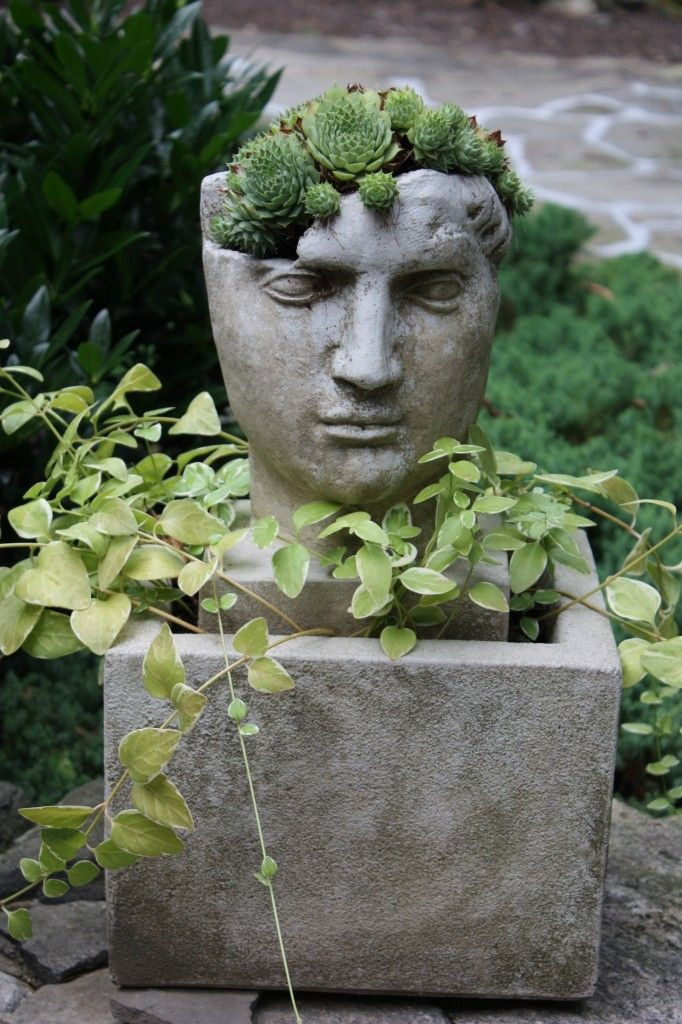 Houten Paaltjes The Artful Garden | Pot Heads, Stone Face Planters