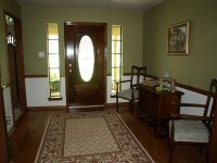 For dining room - stained wood chair rail, tan color walls ...
