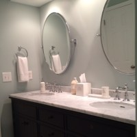 Double vanity, faucets, oval pivot mirrors and bath ...