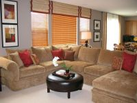 This large sectional sofa divides the living room and ...
