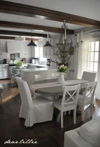 Gray kitchen table w/ White chairs. Adding some Spring ...