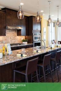 The Finley models eat-in kitchen features dark cabinets ...