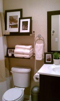 Small bathroom- decorative storage above toulet #bathroom ...