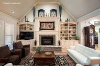 The great room features a #vaulted ceiling, a #fireplace ...