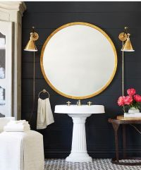 Gorgeous gold round mirror and brass wall sconces in this ...
