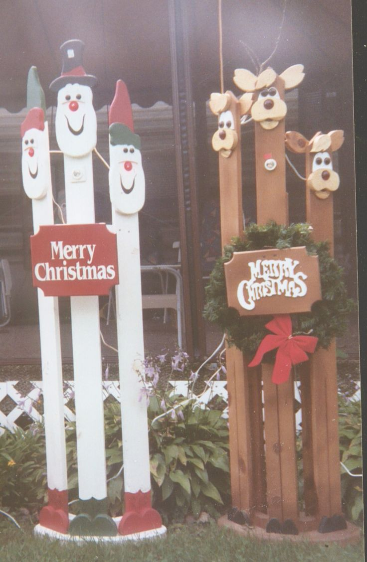 Pictures of crafted wooden painted christmas decorations yard shadows lawn