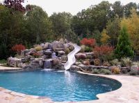 pool slide, love the privacy the stone wall and ...