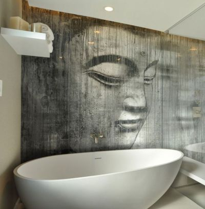 Buddha wallpaper in a bathroom. It's sealed behind a glass panel, and has a special texture ...