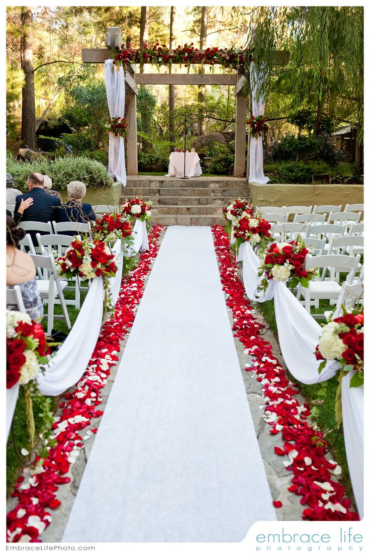 outdoor wedding aisles wedding aisle decorations Red and white wedding ceremony flowers by Floral Fields of Burbank CA