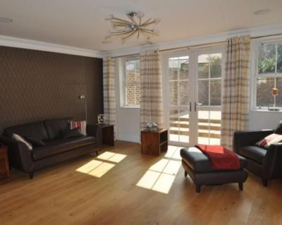 photo of simple brown leather living room with wood flooring chocolate wall feature wall ...