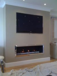 linear fireplace with tile surround and tv above | Decor ...