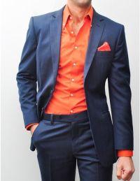 Navy suit with bright reddish-orange shirt and pocket ...