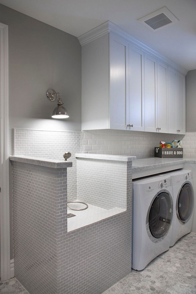 Douche Lamp This Stunning Laundry Room Features White Cabinets And A
