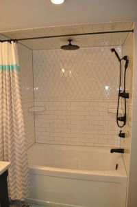 White subway tile shower with grey grout. Black Kingsley ...