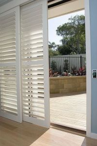 Shutters on sliding patio doors add privacy and soften ...