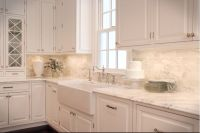 Super white granite counter top. Carrera marble backsplash ...