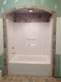 Bathtub tile... Like the idea of tile around and above ...