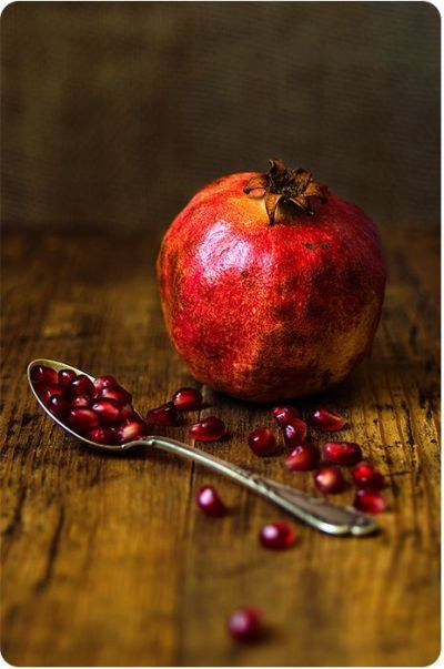 still life photography   Pomegranate fruit and spoon on ...