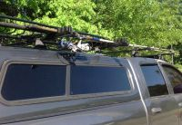 Lockable surf rod or fishing pole holder on the roof rack ...