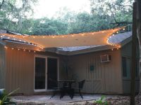Exterior. Patio Sails Sun Shades With Light Over Black ...
