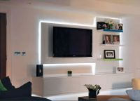 his sleek contemporary high gloss finished media unit uses ...