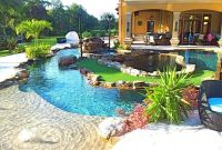 backyard oasis lazy river pool with island lagoon and