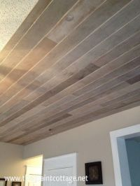Cover a popcorn ceiling with multicolored wood slats ...
