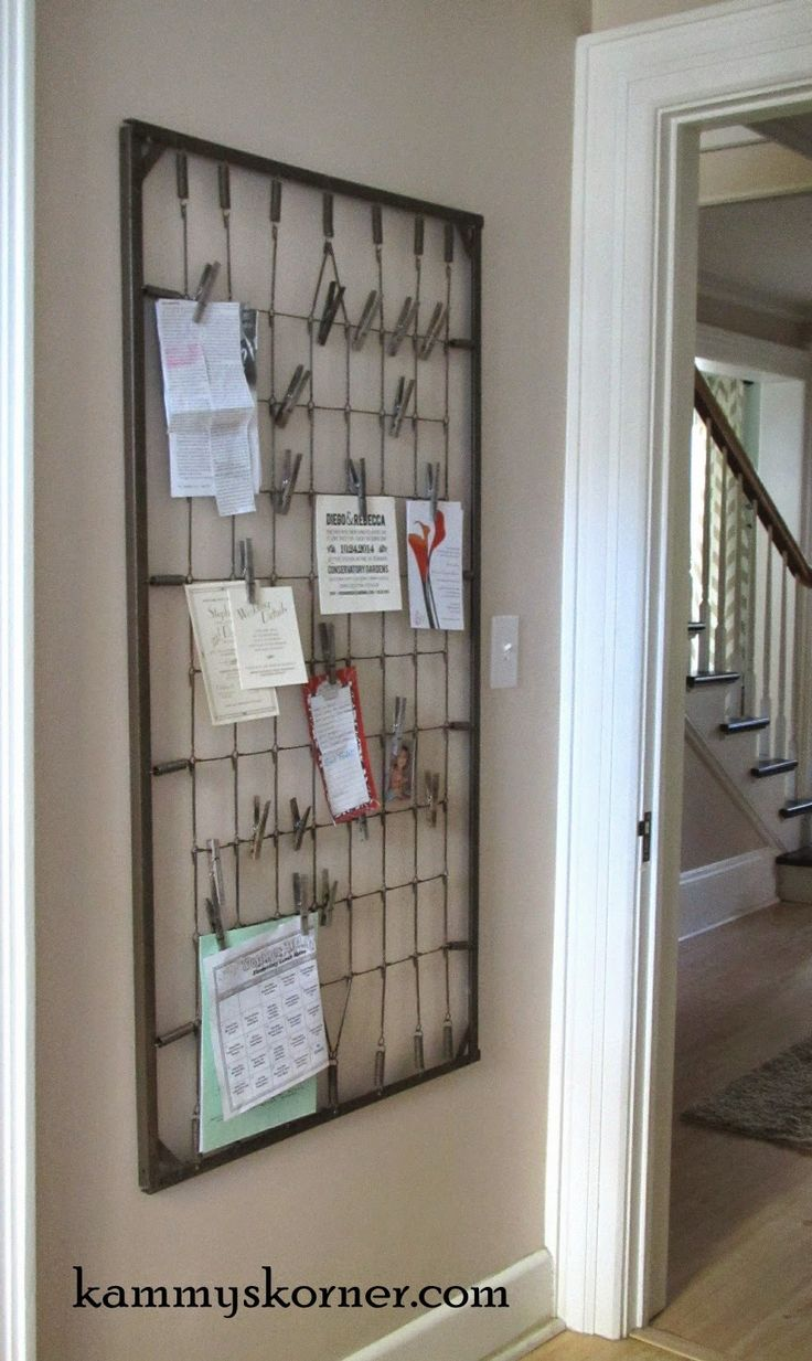 What a great idea using an old crib spring to clip pictures notes