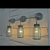 DIY Mason Jar Lights .. bathroom light fixture idea ...