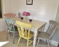 This fabulous dining set has four pastel chairs painted in ...