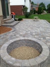 Stone patio with built in fire pit | Outdoor spaces ...