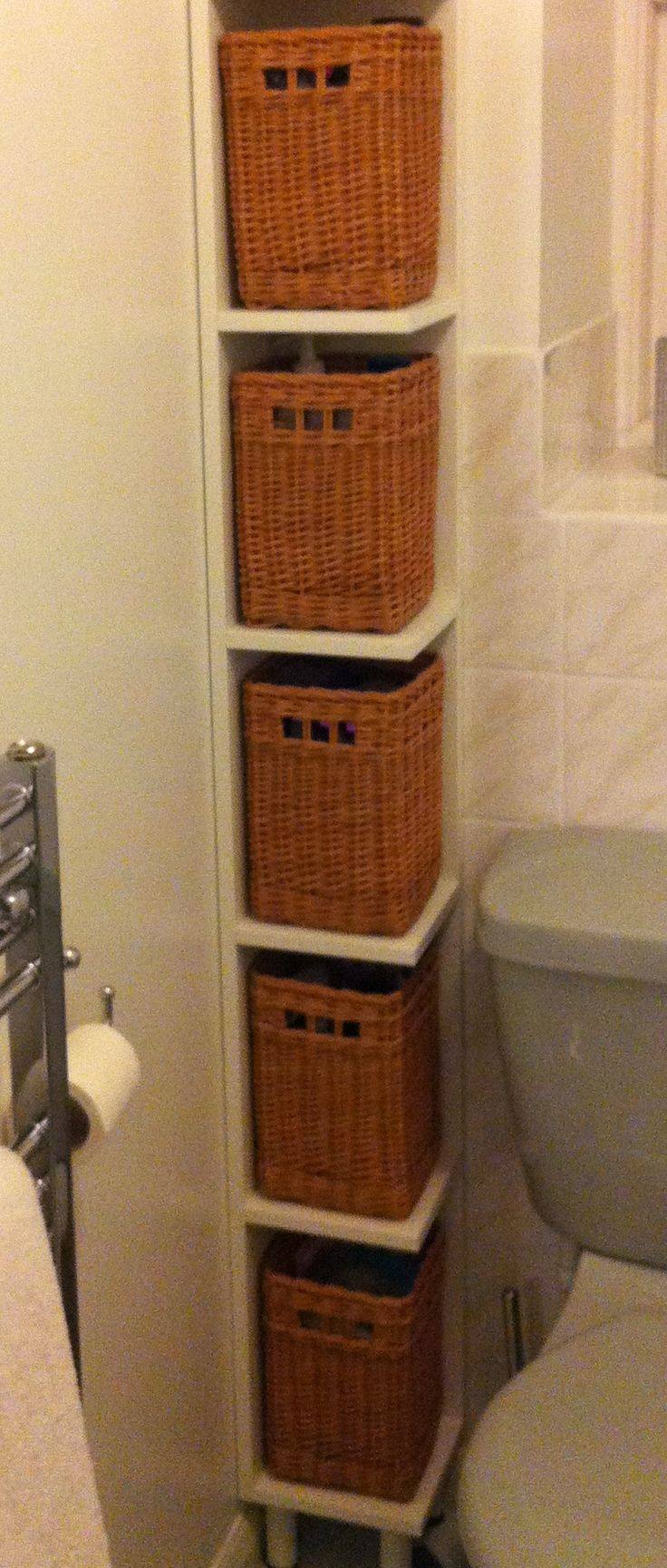 Close Up Of The Bathroom Shelves With Baskets