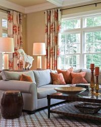 Cream living room with blue-gray, rich brown and rust red ...