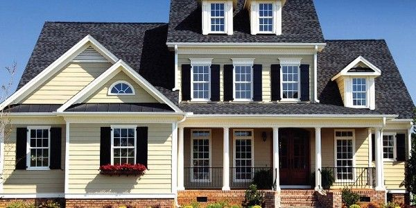 What Color Shutters Go With A Yellow House Cream Colored Siding With Charcoal Roof And Black Shutters