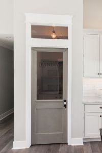Signature Rafterhouse pantry door with transom window ...