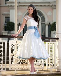 A beautiful, short white wedding dress with blue trimmings ...