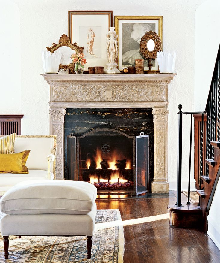 An Original Limestone Mantel Is Topped With Mid Century