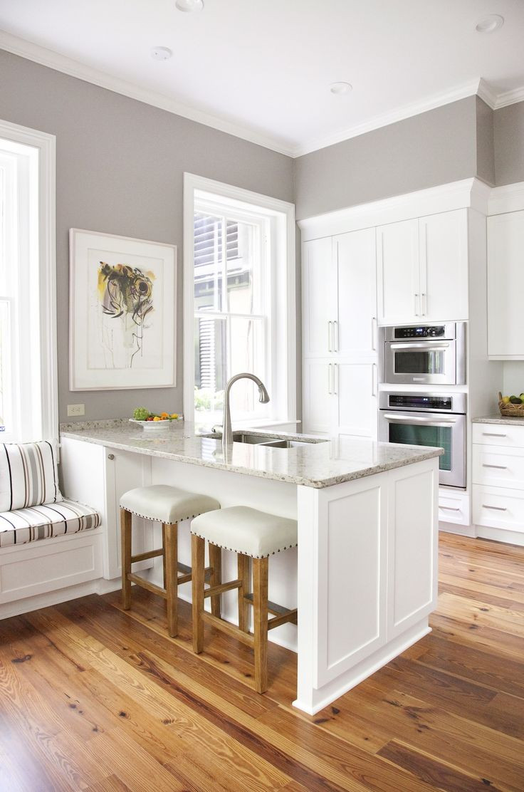 kitchens wood floors in kitchen Sherwin Williams Paint Color Requisite Gray I love the grey walls with the warm wood floor and the white cabinets and bright light for a kitchen or any