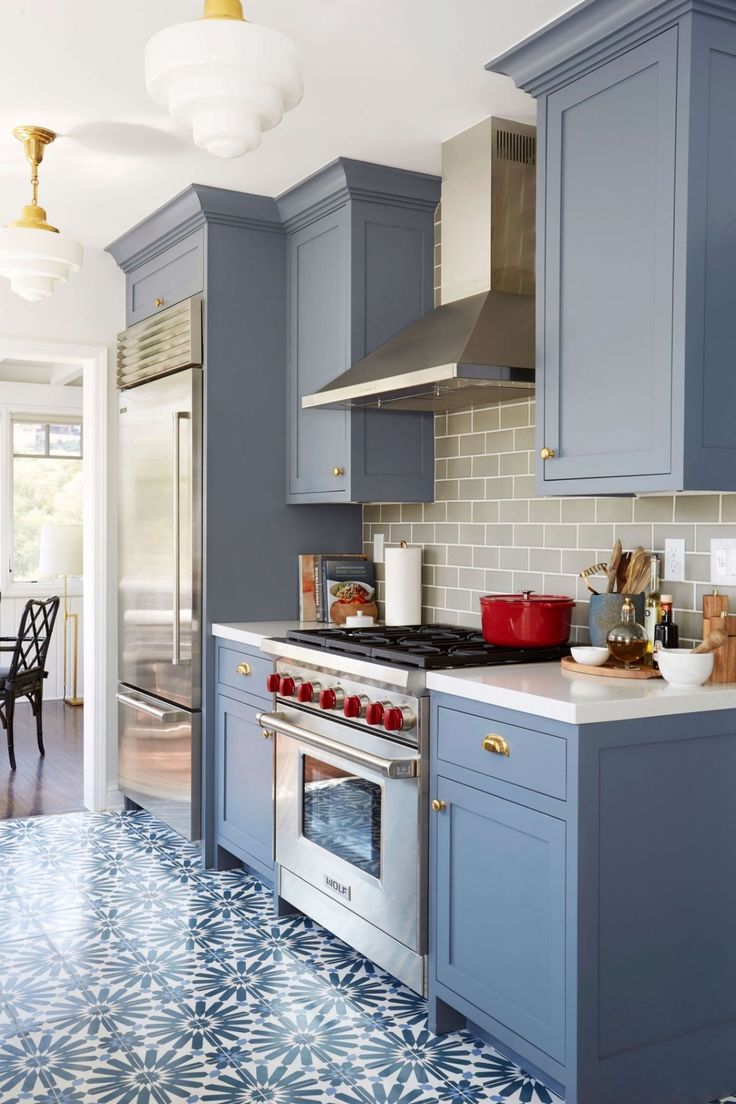 painted kitchen cabinets paint kitchen cabinets Benjamin Moore Wolf Gray painted kitchen cabinets with patterned floor tile and gray subway tile backsplash