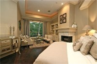 Master Bedroom with fireplace and sitting area overlooks ...