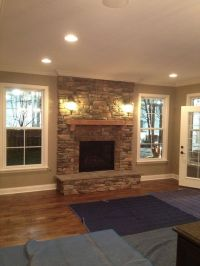 Stone fire place, windows on each side, and put window ...